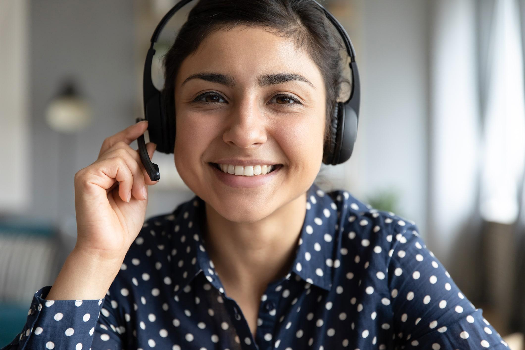 Headshot of woman wearing headset
