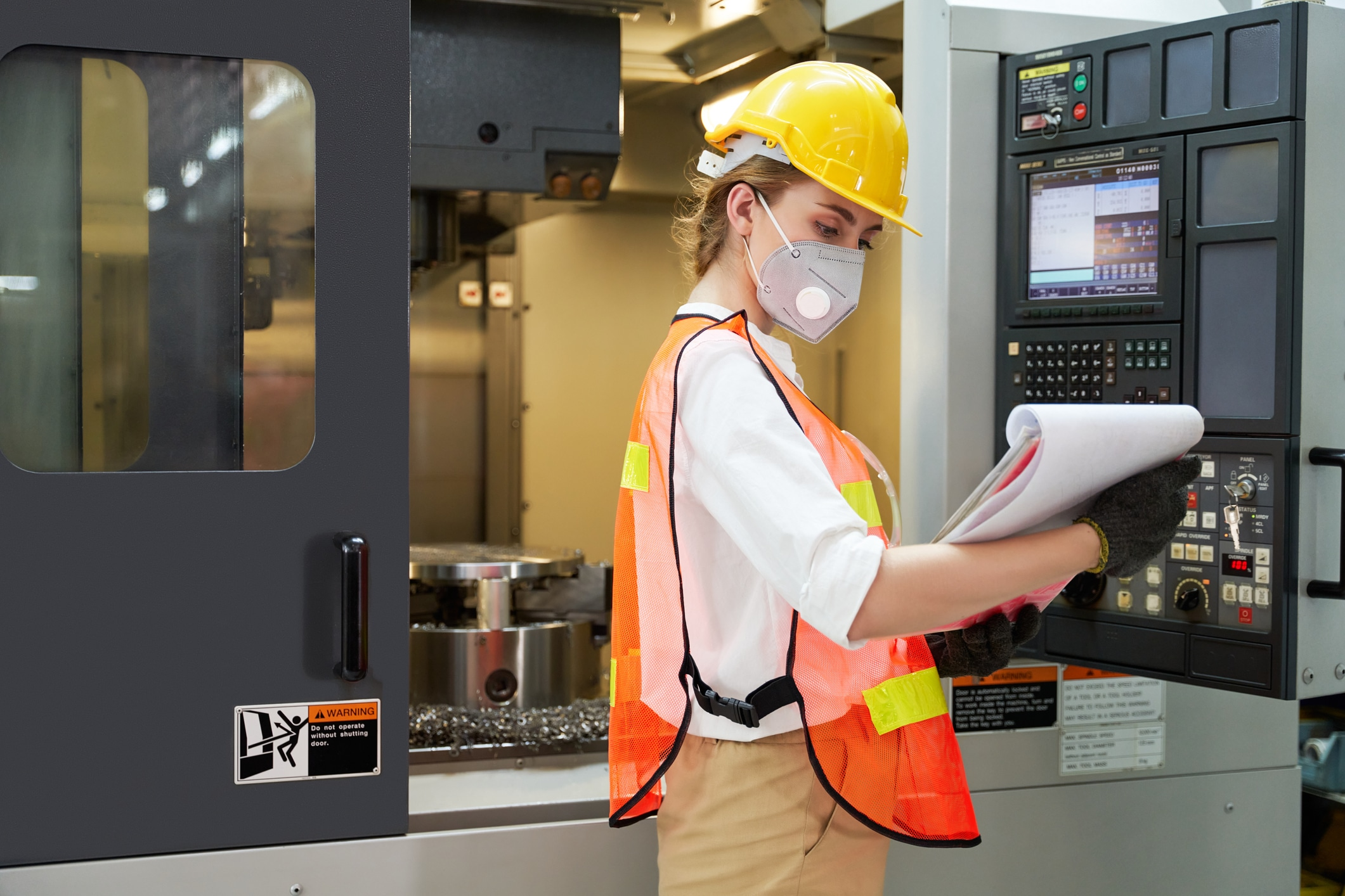 Woman supervisor in factory checking list